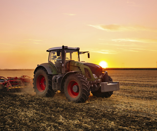 A tractor, covered by a farm fleet insurance policy arranged by CSW Insurance Brokers.