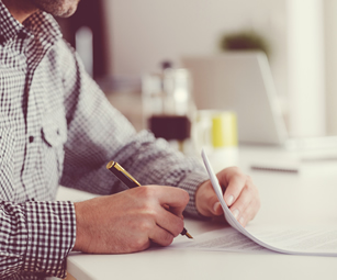 A landlord signing a legal contract. CSW Insurance Brokers can provide landlord legal expenses insurance.