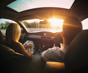 A couple driving, covered by a private car insurance policy arranged by CSW Insurance