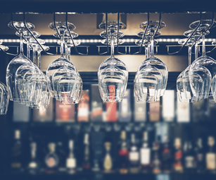 Wine glasses in a restaurant. Protect your business with a pubs & restaurants insurance policy arranged by CSw Insurance Brokers today.