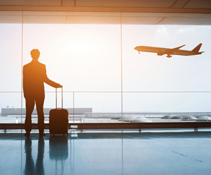 A man waiting for his flight an an airport. Talk to CSW Insurance Brokers for a travel insurance policy tailored to your plans.